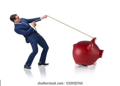 Businessman pulling piggybank with rope