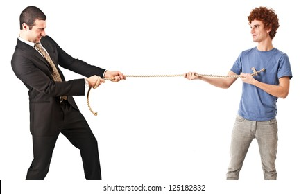 Businessman pulling a rope against a young man
