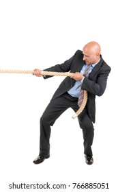 Businessman pulling a rope isolated in white