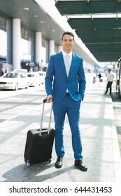 Businessman pulling a trolley in the airport