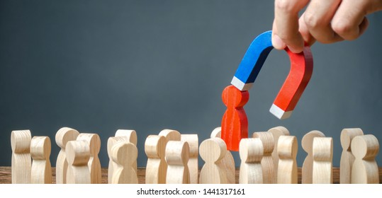 businessman pulls out a red figure of a man from the crowd with the help of a magnet. leader manages the business and forms a team. toxic, incompetent worker. Increase team efficiency, productivity.