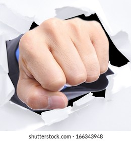 Businessman punch through white paper for slove every problem