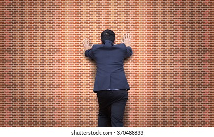 Businessman push the brick wall. Stalemate. Problem.