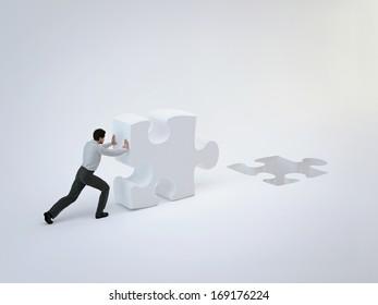 Businessman push puzzle
