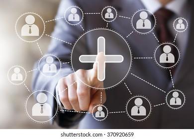 Businessman push virtual web button add plus