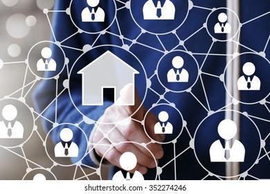 Businessman push web home button house network sign