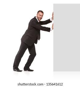 Businessman pushing away something isolated on white background