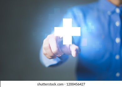 Businessman pushing button positive thing. Business for Profit, Benefit, Development and growth Concepts. Represented by a plus sign