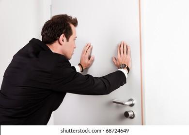Businessman pushing the door
