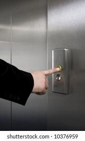 Businessman pushing elevator button
