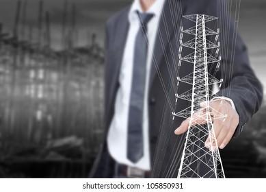 Businessman pushing High voltage power pole line.