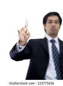 Businessman pushing on a touch screen an imaginary