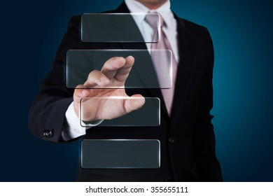 Businessman pushing on a touch screen interface.