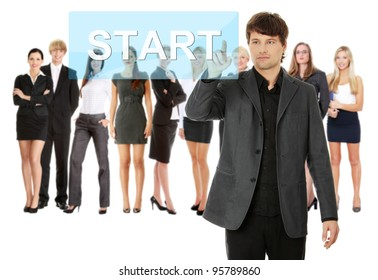 Businessman pushing START on a touch screen interface. Business team at background