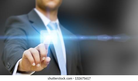 Businessman pushing tactile button