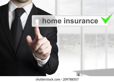 businessman pushing touchscreen button home insurance