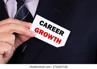 Businessman put card with text Career Growth in pocket. Business concept.
