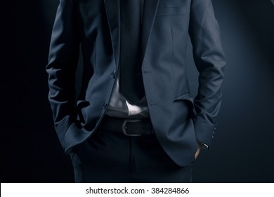 Businessman Put His Hand in His Pocket