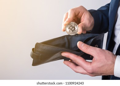 Businessman puts bitcoin in a wallet