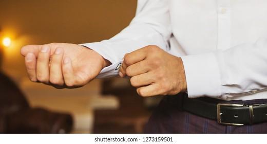 Businessman puts on a white formal stylish shirt. Formal style. Businessman in a classic formal jacket
