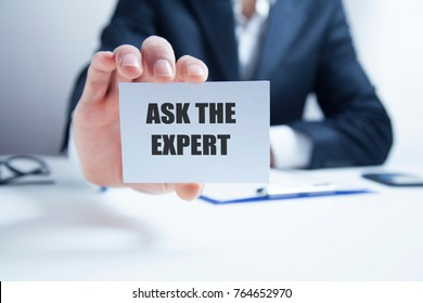 Businessman putting a card with text Ask the Expert