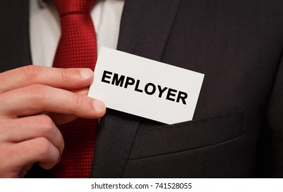 Businessman putting a card with text Employer in the pocket