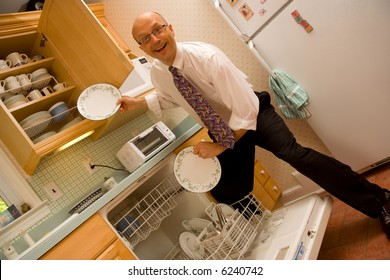 Businessman putting dishes away