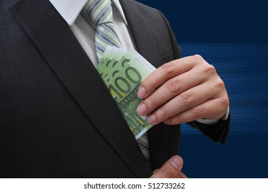Businessman putting euro banknotes in suit pocket, bribe and corruption concept.