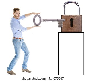 Businessman putting key into lock , success concept and much copyspace for own text beneath the lock. Young man unlocks something photograph