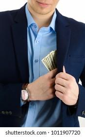 Businessman putting money in his suit pocket - closeup shot
