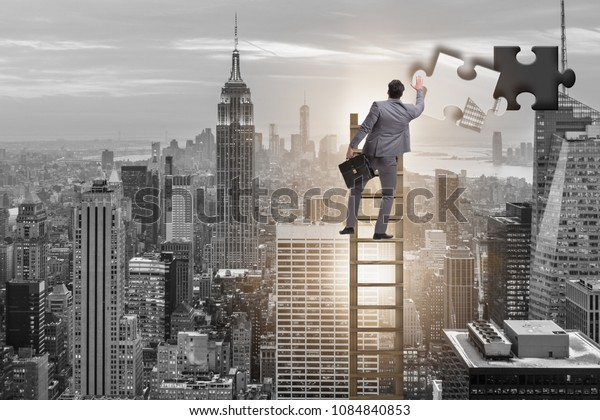 Businessman putting together jigsaw puzzle pieces