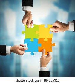 Businessman with puzzle. Concept of teamwork and partnership concept