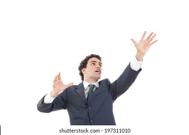 businessman with raised hands reaching for something with blank space, young man in suit reaching for something from above with empty copy space, successful man with idea grabbing something