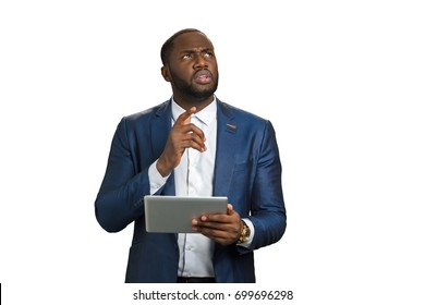 Businessman raised his index finger up. black businessman worriedly thinking with computer tablet. Businessman with computer noted the really important fact.