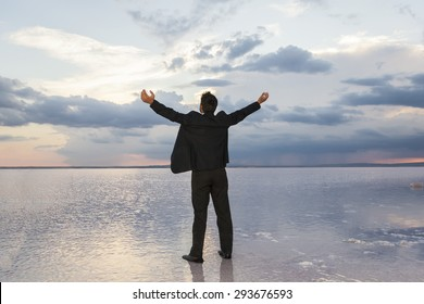 Businessman Raising His Hands or Open arms when sun rising up