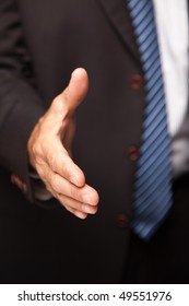 Businessman Reaching His Hand Out for a Handshake.