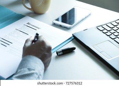 businessman Reading application form resume paper In the office