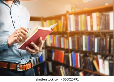 Businessman reading a book in the library
