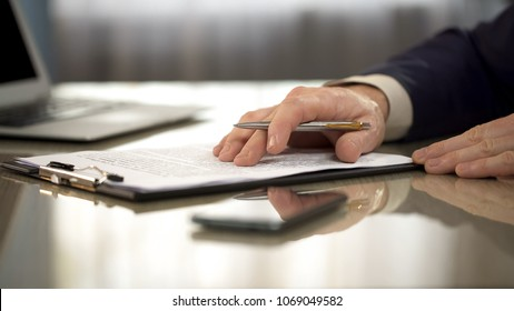 Businessman reading carefully terms, conditions of business contract, close-up, stock footage