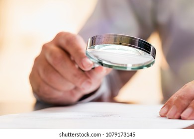 Businessman Reading Contract Details Before Signing