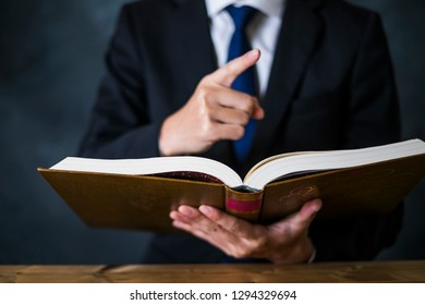 businessman reading a heavy book
