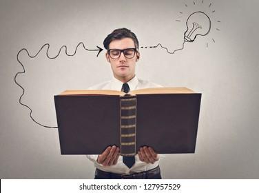 businessman reading a huge book