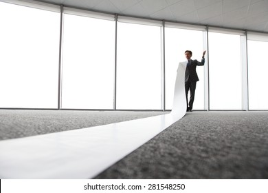 businessman reading long white sheet