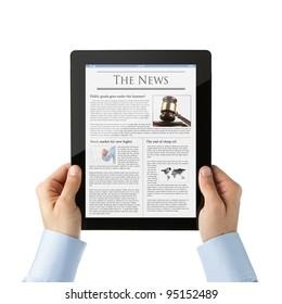 Businessman reading news at digital tablet