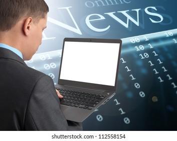 Businessman reading news at laptop computer