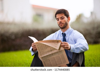 Businessman reading the newspaper