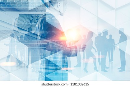 Businessman reading papers over a crowded office background. Geometric pattern and cityscape. Concept of leadership in business. Toned image double exposure mock up