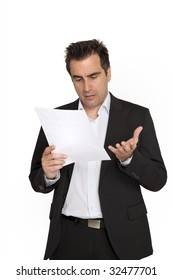 Businessman reads a document with query