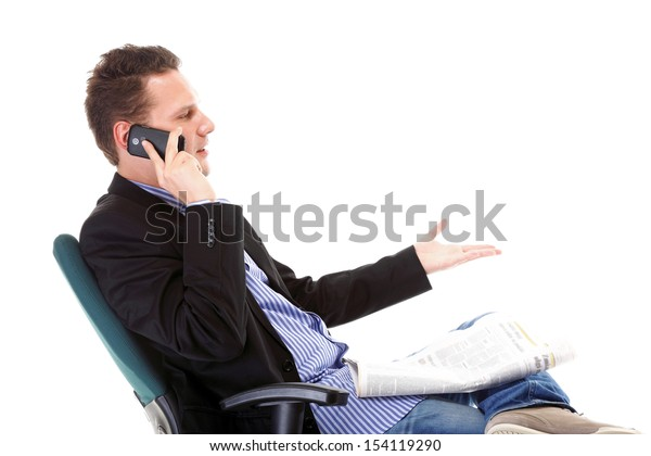 businessman reads newspaper phoning talking on mobile phone commenting economy news isolated on white background