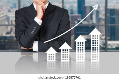 Businessman and real estate market. Meeting room.
